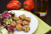 Chicken meatballs with salad and beefsteak tomatoes — Stock Photo