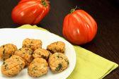 Chicken meatballs with beefsteak tomatoes — Stock Photo