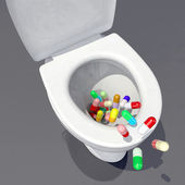 Pills in the toilet — Stock Photo