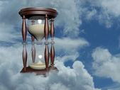 Hourglass in the blue sky — Stock Photo