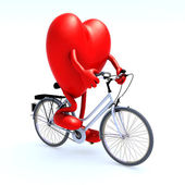 Heart riding a bicycle — Stock Photo