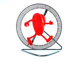 Heart with arms and legs in hamster wheel — Stockfoto