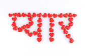 Word love in Hindi with small red hearts — Stock Photo