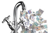 Tap water with English banknotes — Stock Photo
