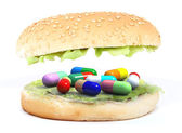 Colored pills in the sandwich — Stock Photo