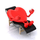 Heart that rests on a chaise longue — Stock Photo