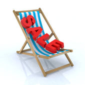 Beach chair with sale written — Stock Photo