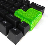 Keyboard with enter button in green grass — Stock Photo