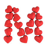 Letter M with red hearts — Stock Photo