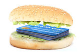 Sandwich stuffed with a credit cards — Stock Photo