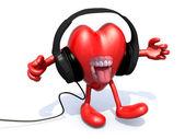 Headphones on a big heart — Stock Photo