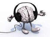 Headphones on a big brain with arms and legs — Stock Photo