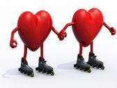 два сердца с руки, ноги и роликовых коньках — Стоковое фото
