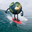 Earth with arms and legs surfing on the sea — Stock Photo
