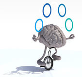 Brain juggle with arms and legs rides a unicycle — Stock Photo