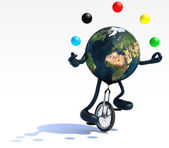 Earth juggle with arms and legs rides a unicycle — Stock Photo