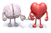 Brain and heart with arms and legs linked by handcuffs on hand — Stock Photo