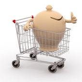 Moneybox in a shopping cart ok — Stock Photo
