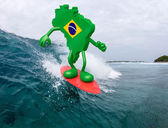 Brasilian map with arms and legs on surf board — Stock Photo