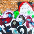 Stock Photo: Brick wall graffiti 4