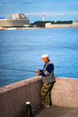 Fisherman on the banks of the Neva — Stock Photo