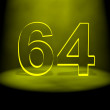 Number 64 illuminated with yellow light - Stock Photo