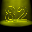 Royalty-Free Stock Photo: Number 82 illuminated with yellow light