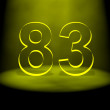 Royalty-Free Stock Photo: Number 83 illuminated with yellow light