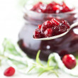 Cranberry sauce in glass jar — Photo