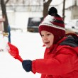 Little boy is playing in snow — Stock Photo