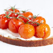 Bruschetta with baked tomatoes — Stock Photo #16259497