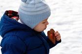 Baby with valentine cookie — Stock Photo