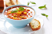 Minestrone soup with bread — Stock Photo