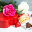 Gift box, chocolate and flowers — Stock Photo