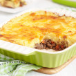 Cottage pie in baking dish - Stok fotoğraf