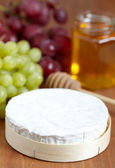 Brie cheese on a wooden board — Stock Photo