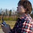 Young man controls RC plane in the sky - Stock Photo