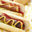 Grilled hot dogs with mustard, ketchup and relish — Stock Photo #24893765