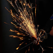 Sparks while sawing metal. close up — Foto Stock