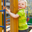 Stock Photo: Little boy is playing on playground