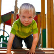 Little boy is playing on playground — Stock Photo
