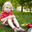Portrait of little boy with a bicycle — Stock Photo