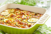 Casserole with cheese and zucchini in baking dish — Stock Photo