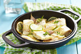 Baked fish fillet with lime and garlic — Stock Photo