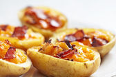 Potato skin with bacon and cheese — Stock Photo
