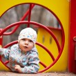 Stock Photo: Little boy playing at playground