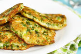Green pancakes with zucchini and herbs — Stock Photo