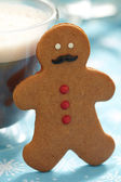 Gingerbread man in hot chocolate — Stock Photo