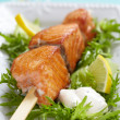 Delicious roasted salmon on skewers — Stock Photo