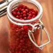 Pink Peppercorns In Spice Jar — Stock Photo #38714759